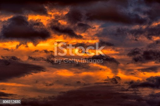 istock Fire in sky yellow dark storm clouds 936312630