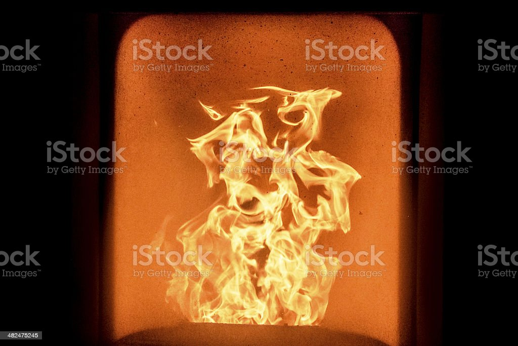Fire in stove stock photo