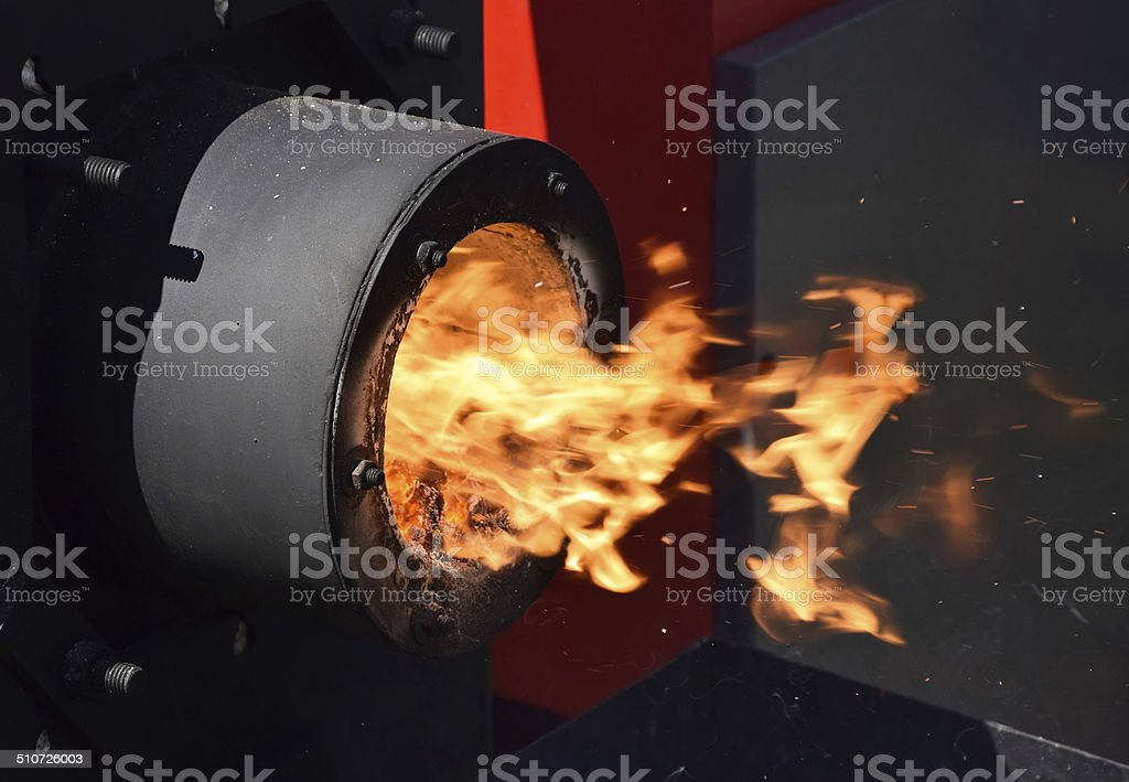 Fire in the boiler stock photo