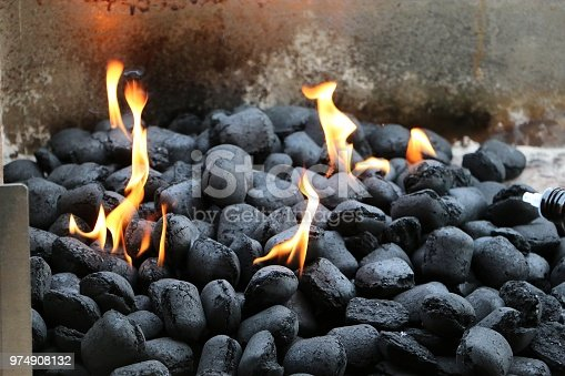 burning charcoal in the grill