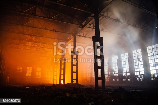 istock Fire in the factory. Burned by fire industrial building 891080570