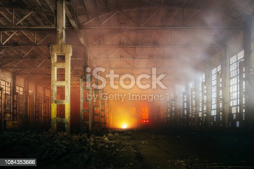 istock Fire in the factory. Ruined building full of smoke 1084353666
