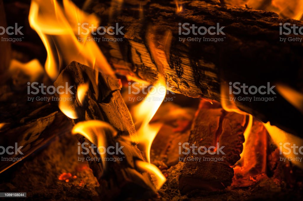 fire in the fireplace. Close up view of fire flames stock photo