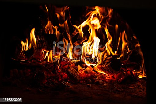 fire in the oven. Firewood is enveloped in flames.
