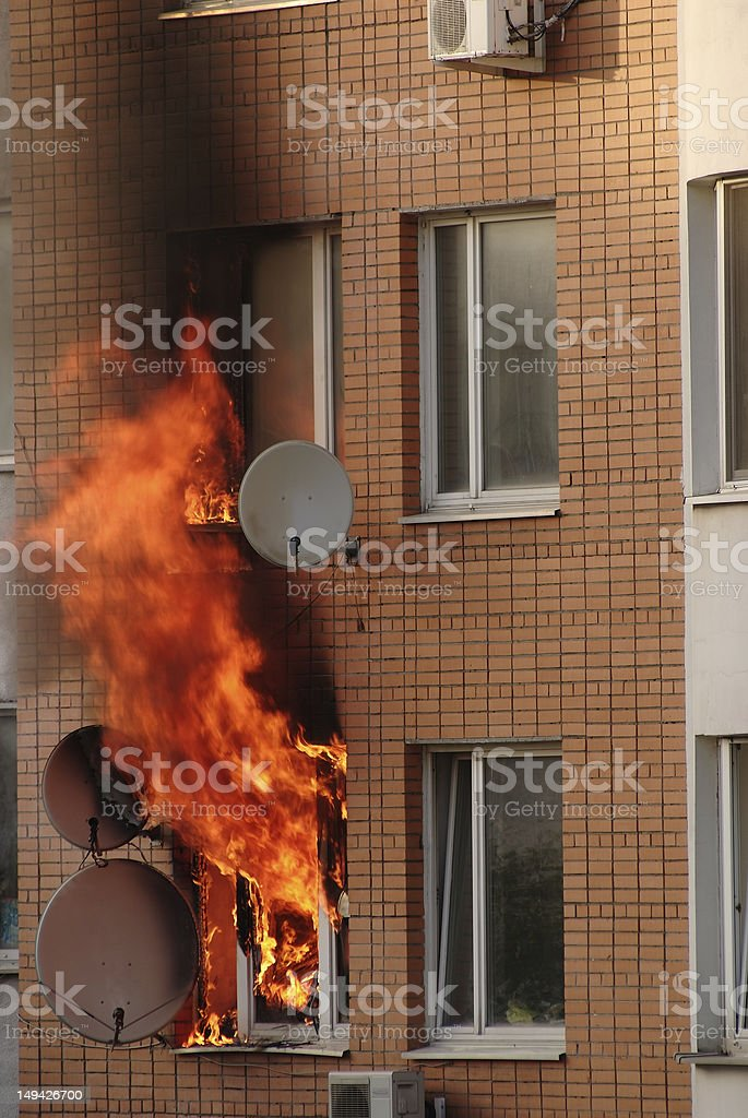 Fire in the window of building stock photo