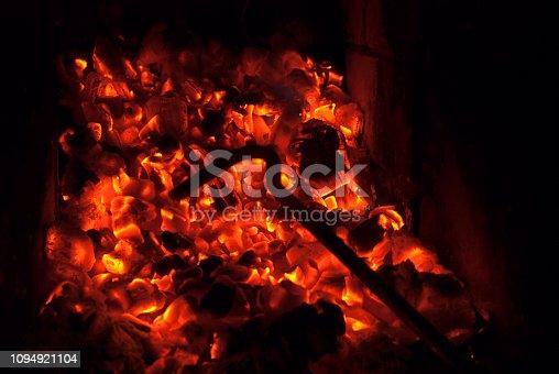 istock fire iron background on burning coals 1094921104