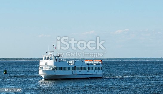 A ferry boat transporting people from Fire Island to Bay shore travelling in the Great South Bay.
