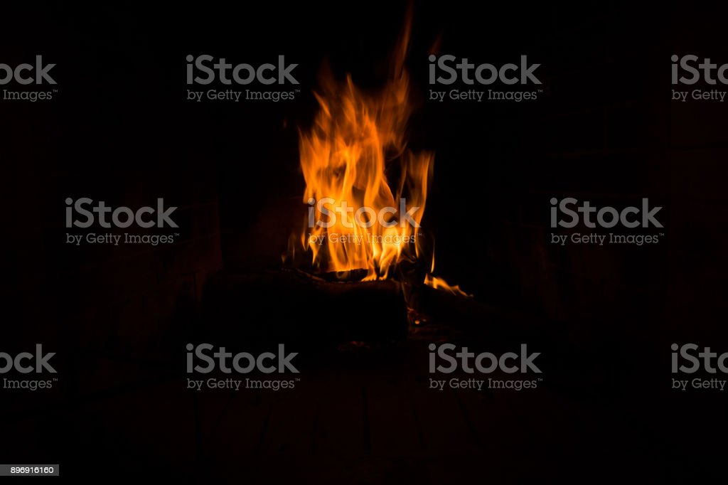 fire isolated in black woods fireplace for background dark stock photo