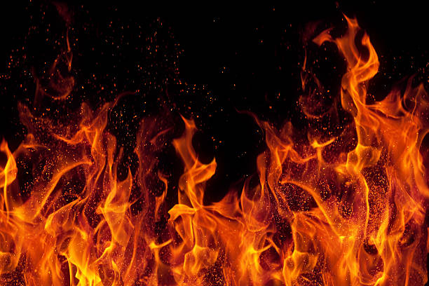 fire isolated over black background - black background stock pictures, royalty-free photos & images