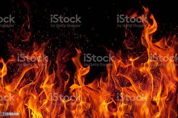 Fire Isolated Over Black Background Stock Photo - Download Image Now