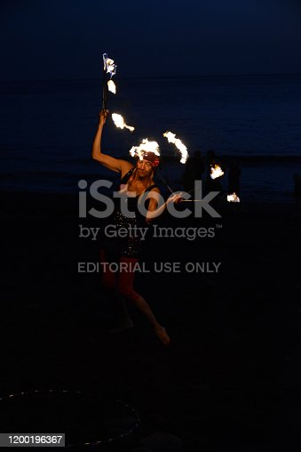 Valle Gran Rey, La Gomera, 03/09/2015 silhouettes of fire juggler at beach during sunset