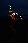 Valle Gran Rey, La Gomera, 03/09/2015\nsilhouettes of fire juggler at beach during sunset