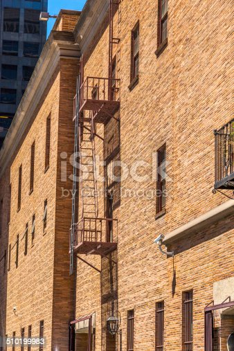 istock fire ladder at an old Brick house 510199983
