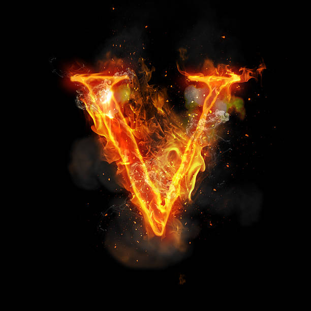 Fire letter V of burning flame light stock photo