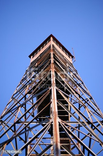 Looking up along support of fire lookout tower with copy space above