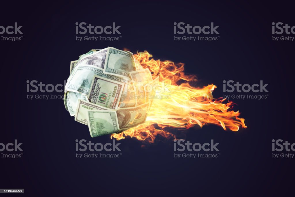 Fire money ball of dollar bills going up like a comet in space. Concept of the rapid development of financial profit stock photo
