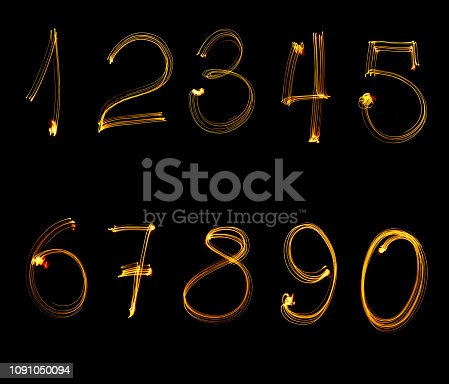 513641036istockphoto fire numbers, from 0 to 9, on a black background. 1091050094