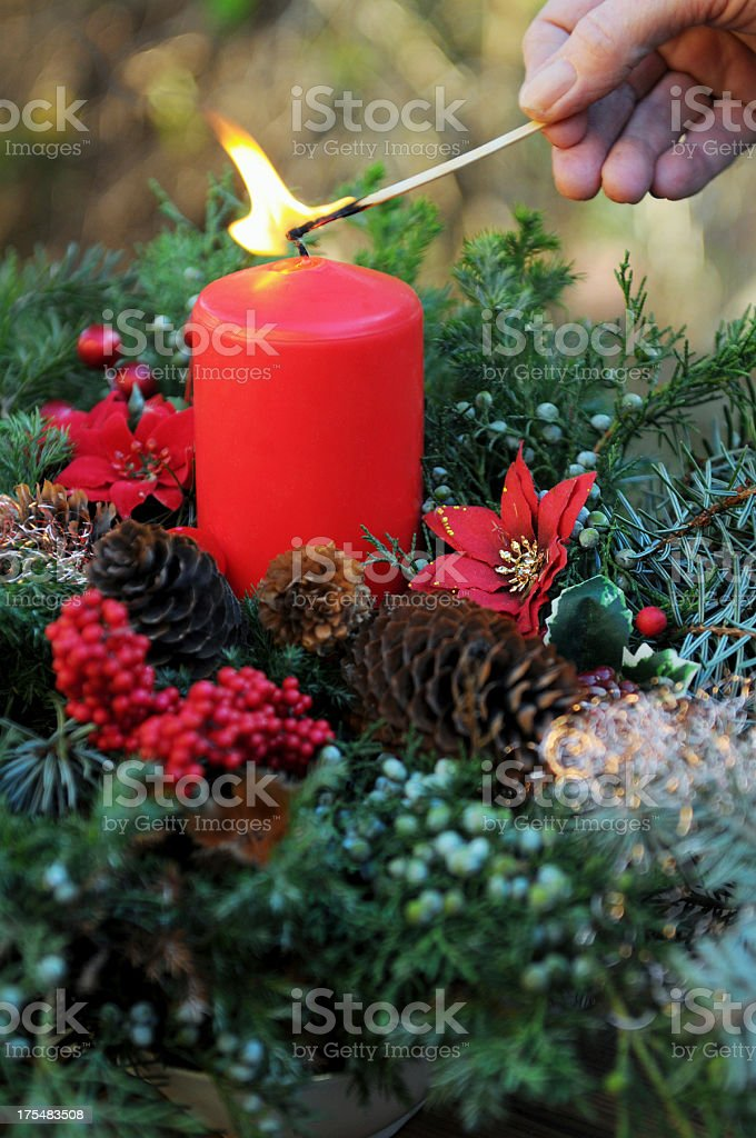 fire on Advent wreath with red candle and ornaments royalty-free stock photo