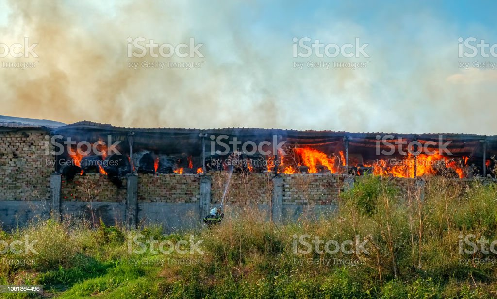 Fire on barn with straw stock photo