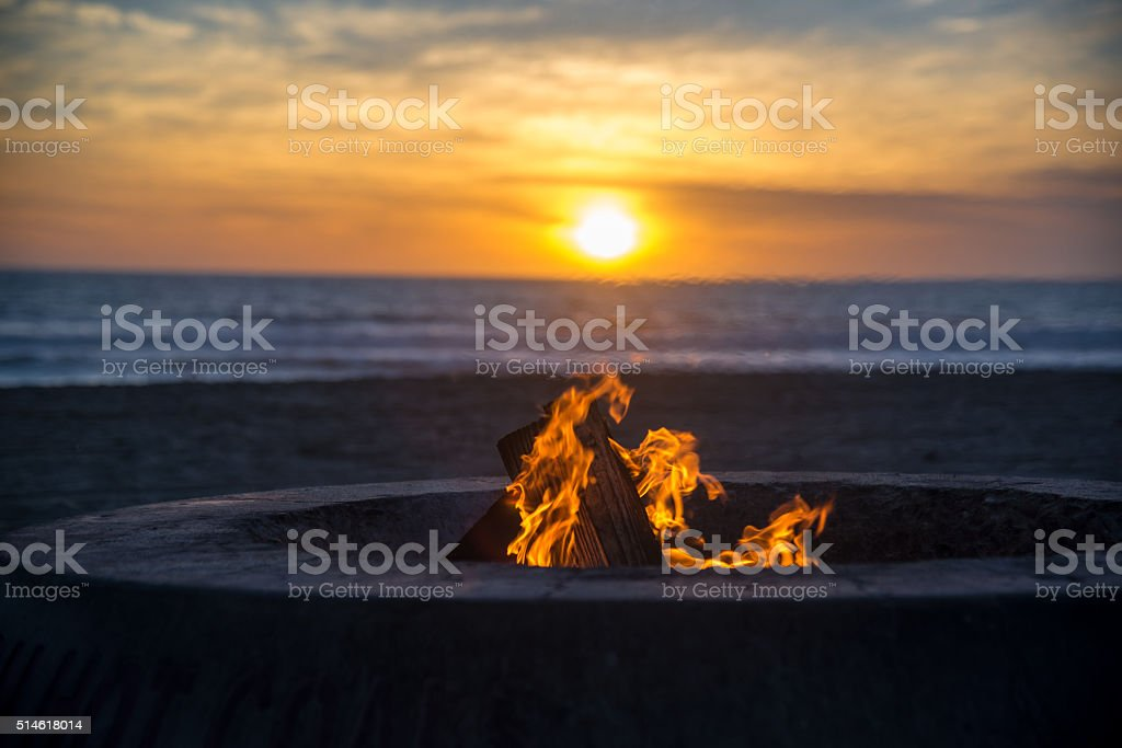 fire on the beach stock photo