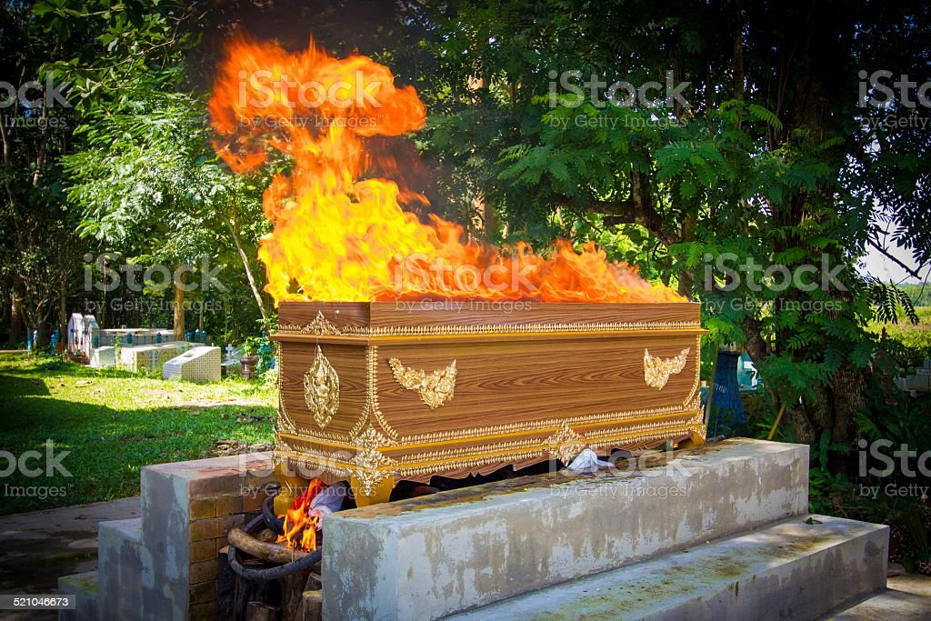 fire on the coffin for cremation stock photo