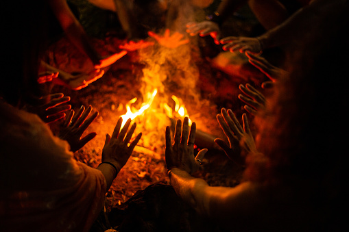 Ritual around the campfire. Bonfire flames on pieces of firewood.