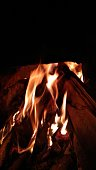 a fire burning in the dark was red hot burning wood