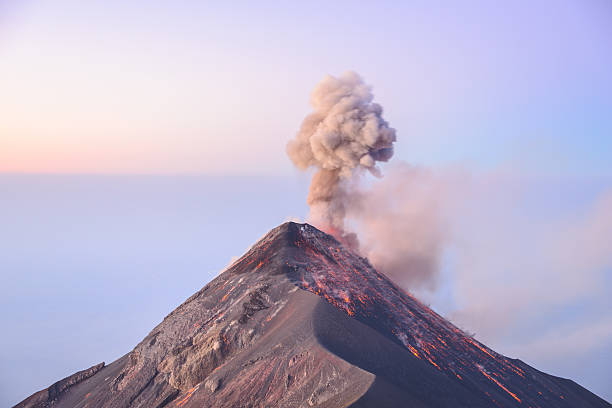 Fuego Sunrise eruption at Volcan Fuego in Guatemala volcano stock pictures, royalty-free photos & images