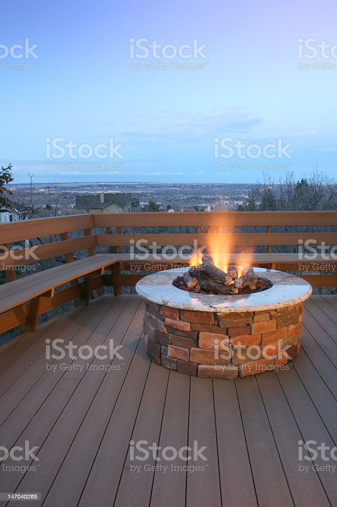 Fire pit on deck with bench seating stock photo