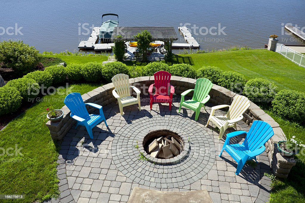 Fire Pit On Hill Overlooking Boat Dock stock photo