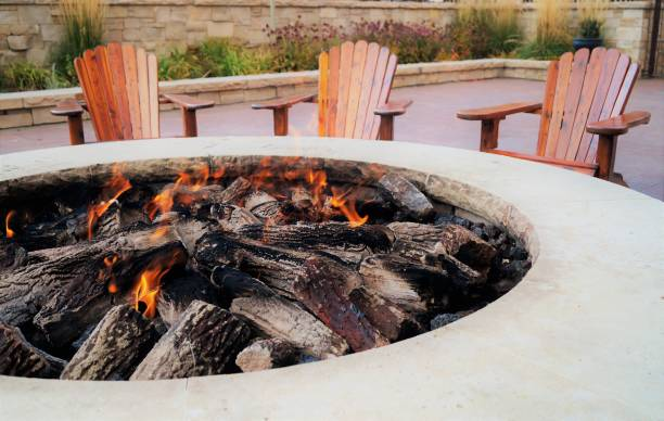 Fire pit Adirondack chairs by the fire pit ski resort stock pictures, royalty-free photos & images