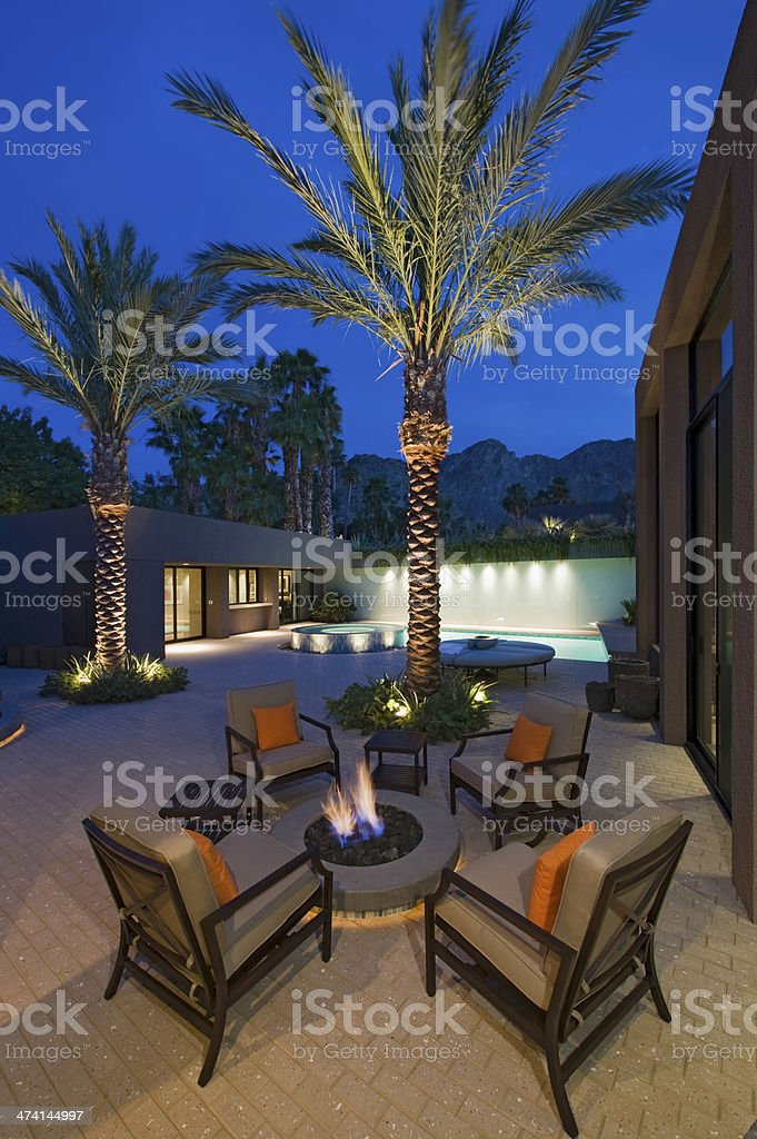 Fire Pit Surrounded By Chairs stock photo