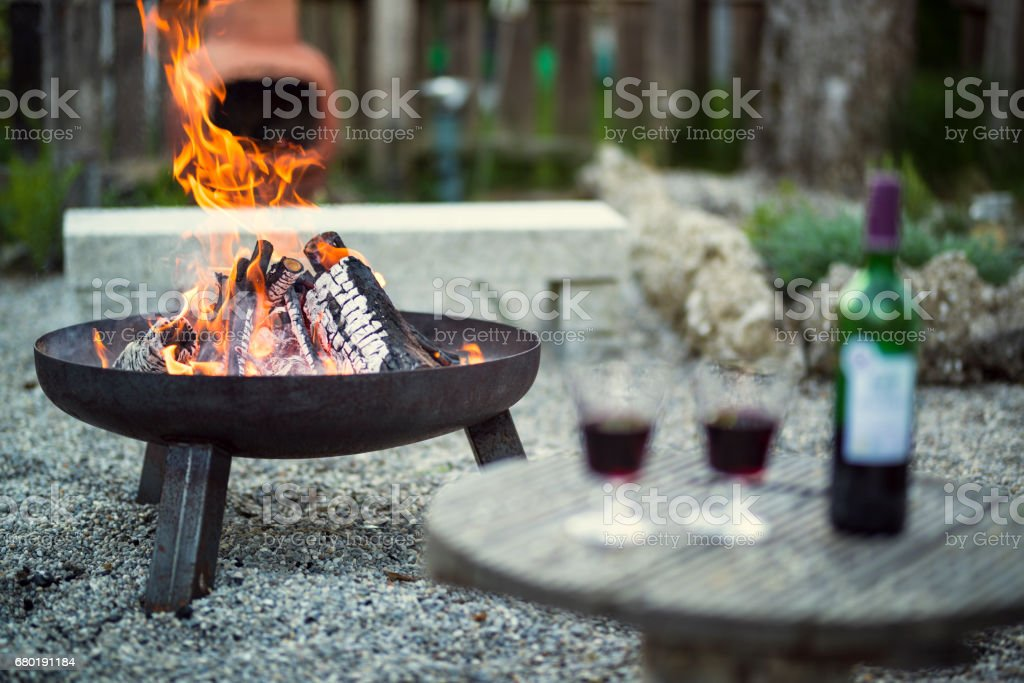 fire pit with wine stock photo
