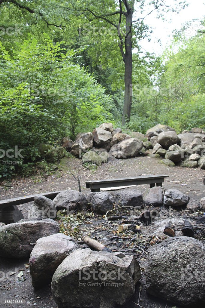 fire pit with wooden benches royalty-free stock photo