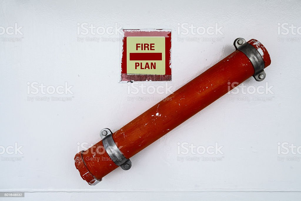 Fire plans on wall stock photo