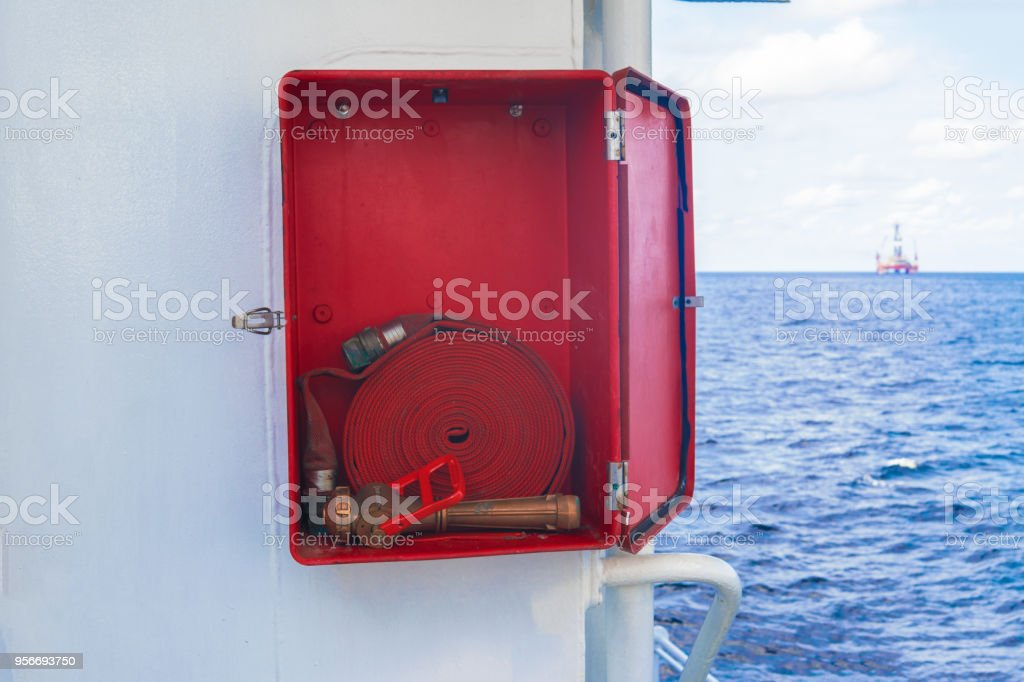 Fire prevention onboard vessel at sea. Fire cabinet with fire equipment stock photo
