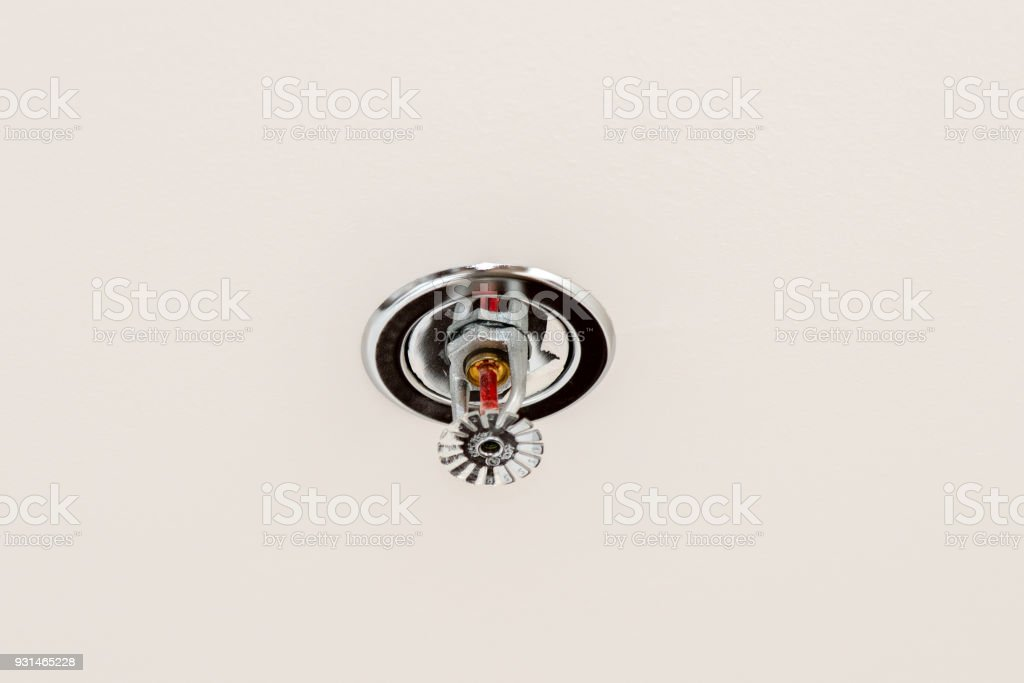 Fire protection. Fire sprinkler head on white ceiling. stock photo