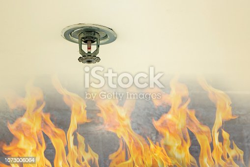 Fire protection.Fire sprinkler head on white ceiling in the building, sensor action when the smoke detected. Automatic head fire sprinkler extinguisher on white ceiling.
