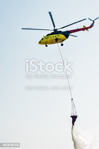 istock Fire rescue helicopter MI-8 wth water bucket 492608200