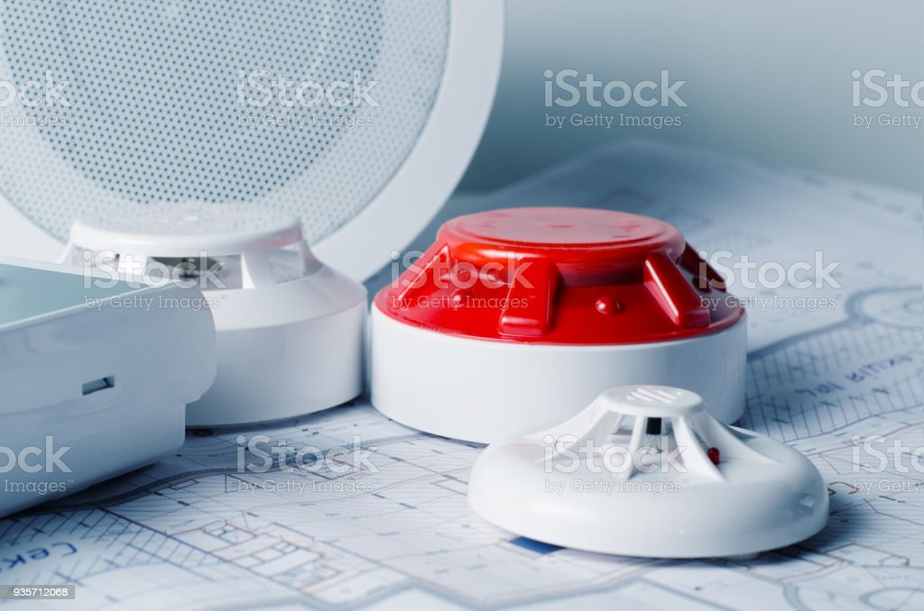 Fire security equipment and blueprint on a table. Good for security servise engeniering company site stock photo