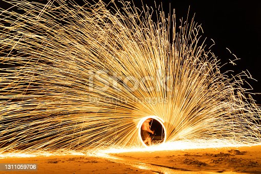 Fire show on the beach at Samed island, Rayong, Thailand.