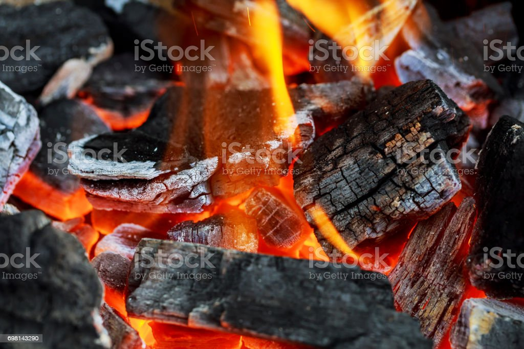 Fire showing piled logs burning in a fire place stock photo