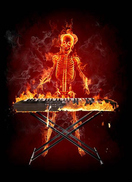 Fire skeleton - keyboardist stock photo