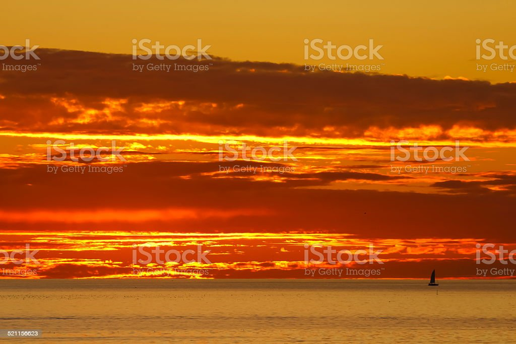 Fire Sky with Sailboat stock photo