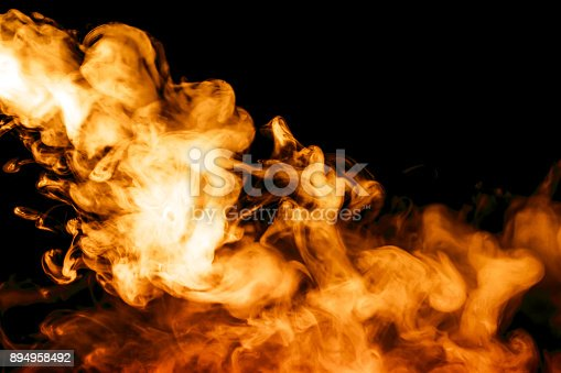 istock fire smoke isolated on a black background. fractal. spiral. 894958492