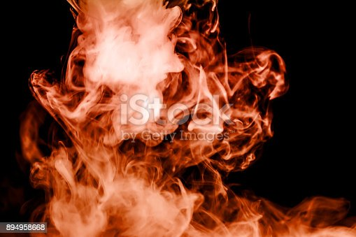 874895030istockphoto fire smoke isolated on a black background. fractal. spiral. 894958668