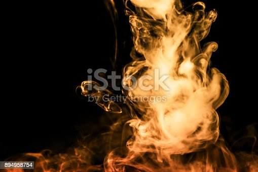 istock fire smoke isolated on a black background. fractal. spiral. 894958754