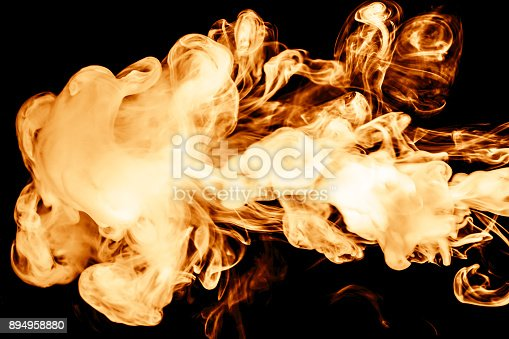 istock fire smoke isolated on a black background. fractal. spiral. 894958880