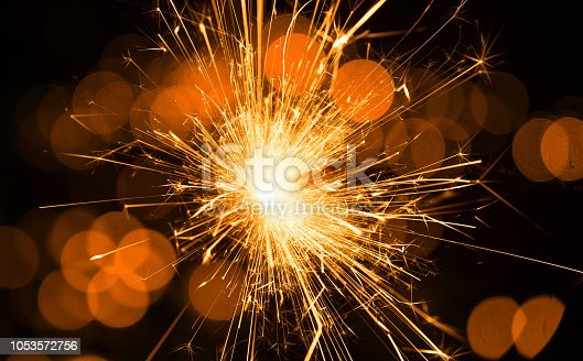 istock Fire Sparkle With Defocused Lights 1053572756