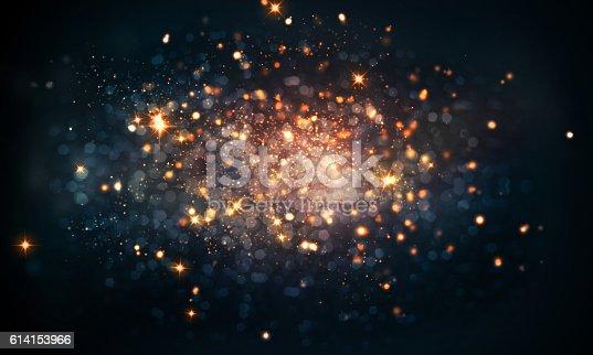 istock fire sparkles bokeh background 614153966